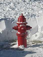 Fire hydrant surrounded by snow