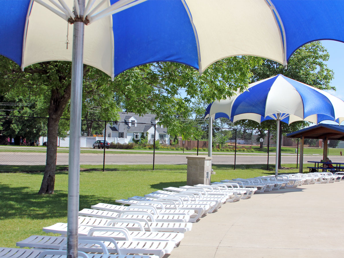 Aquatic Center—Sun umbrellas and lounge chairs.